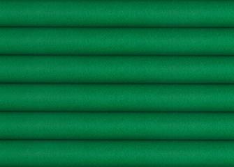 Stack of green woolen fabrics