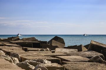 Italy, Sicily, Scoglitti, fishing boats and concrete blocks