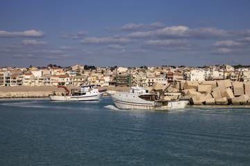 Italy, Sicily, Scoglitti, fishing boats entering the port