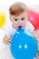 Baby boy and ballons