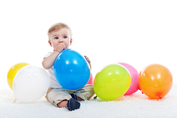 Baby boy with balloons