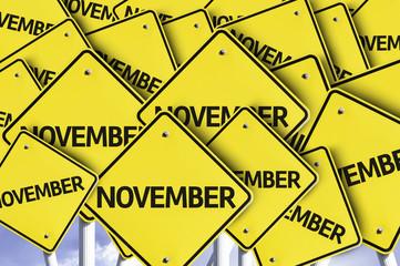 November written on multiple road sign