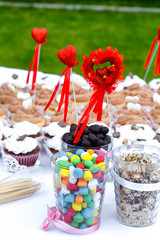 colorful sweets with hearts on the banquet table