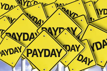 Payday written on multiple road sign