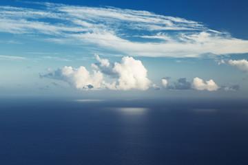 Big cloud hung over the ocean