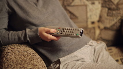 Hand With TV Remote Switching TV Channels