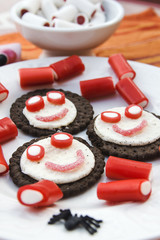 Smiling and funny cookies with sweets