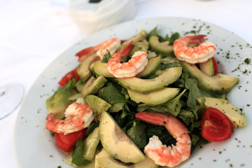 Plate with shrimp and vegetables salad
