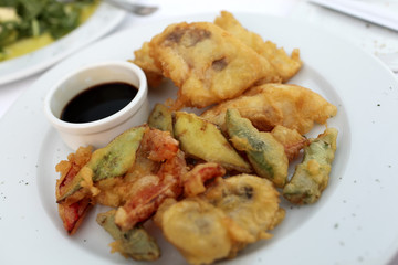 Plate with tempura fish and vegetables