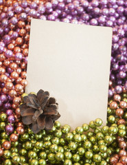 Beads, Christmas-tree and pine cone greeting card