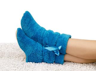 female legs in slippers