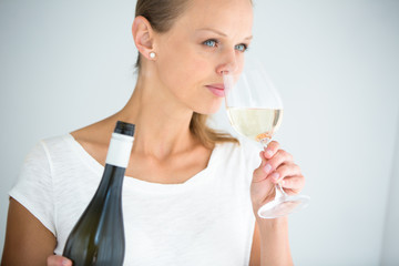 Gorgeous young woman with a glass of wine