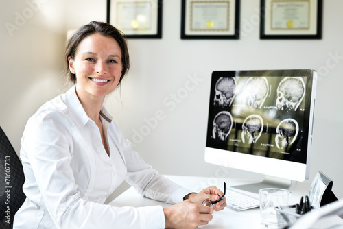 Female Doctor in Office - 71607733