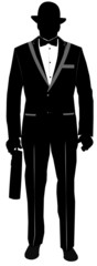 man in tuxedo carrying briefcase in silhouette
