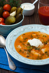 soup with pickles, potato, tomato and sour cream