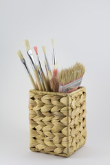 Set of paintbrushes in a pot