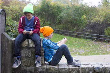 two boys with phones
