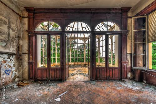 Leinwanddruck Bild Abandoned room with view through beautiful broken conservatory