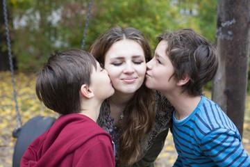 two boys kissing a teenage girl