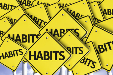 Habits written on multiple road sign