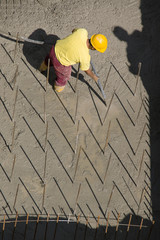 Construction worker vibrating concrete foundations