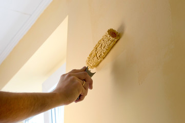 The process of painting the walls in yellow color