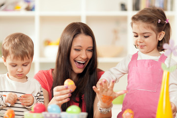 Family decorating Easter eggs