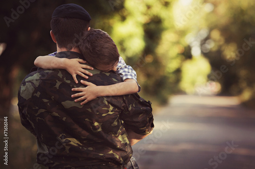 Woman and soldier in a military uniform say goodbye - 71616144