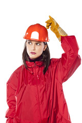 young helmeted woman worker scratching her helmet