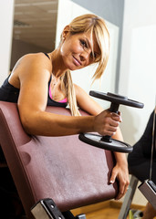 athletic woman pumping up muscles