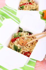 Chinese noodles and sticks in takeaway boxes