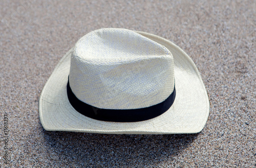 canvas print picture Straw hat on the sand