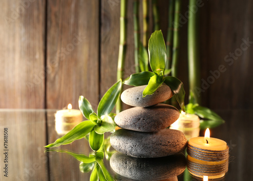 Spa stones, candles and bamboo branches