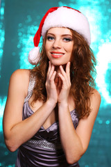 Portrait of beautiful young woman on bright background
