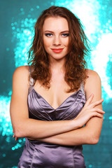 Portrait of beautiful young female on bright blue background