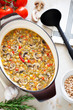 Soup with chickpeas and vegetables in cast iron pan