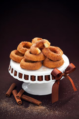 Donuts with cinnamon on cakestand; selective focus