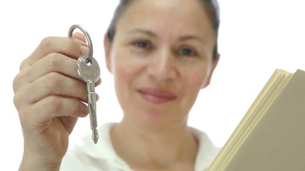 Female Saleswoman Giving Keys