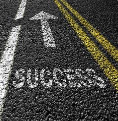 success on the asphalt road