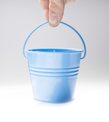 Hand holding little bucket