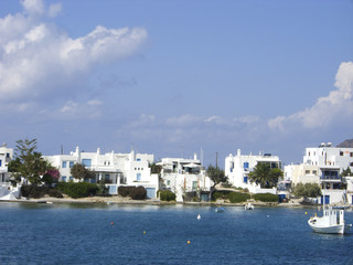 typical beach community with Cyclades style white house blue doo