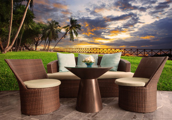 rattan chairs in outdoor terrace living room against beautiful s