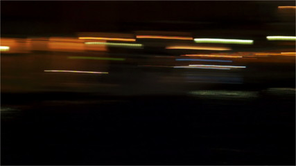 Moving bokeh of night traffic.