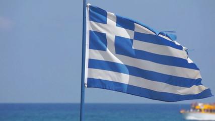 Greek flag waving in blue sky