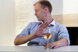 Man refuses to drink a glass of wine