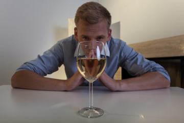 Addicted man with glass of wine
