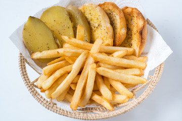 French fries in a Basket on white background