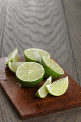 sliced limes on wooden board