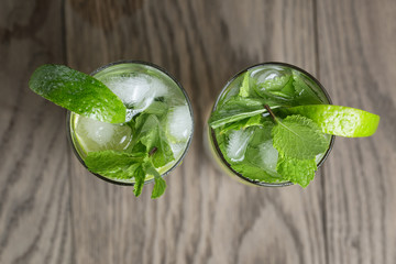 two mojito cocktails on old oak table