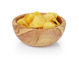 potato chips with paprika in olive bowl